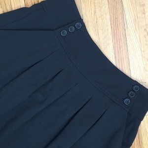 Theory midi with wide pleats and button detail